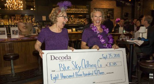 Margaret Sutherland and Marilyn Cobban holding a cheque.