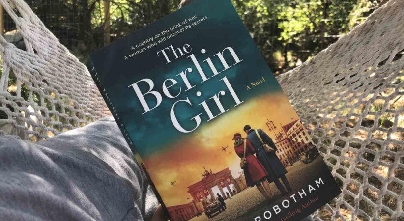 """The book """"The Berlin Girl"""" on top of a hammock."""