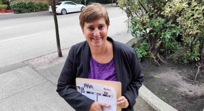 Gail Hanney holding a trivia clipboard