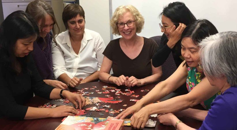 Part of the Decoda staff working on a jigsaw puzzle