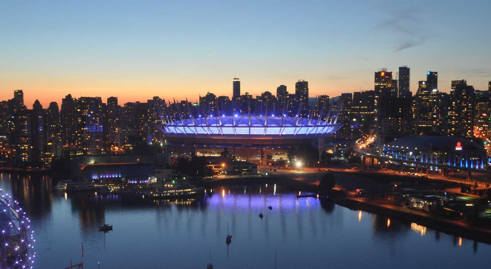 BC Place and Science World light up in purple for literacy month.