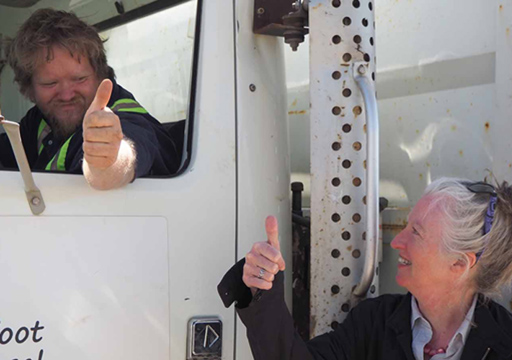 Woman and man in truck with thumbs up
