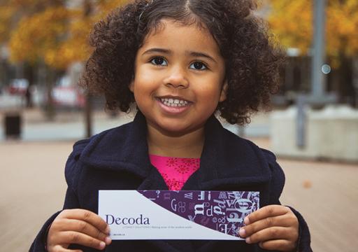 Little girl holding Decoda document