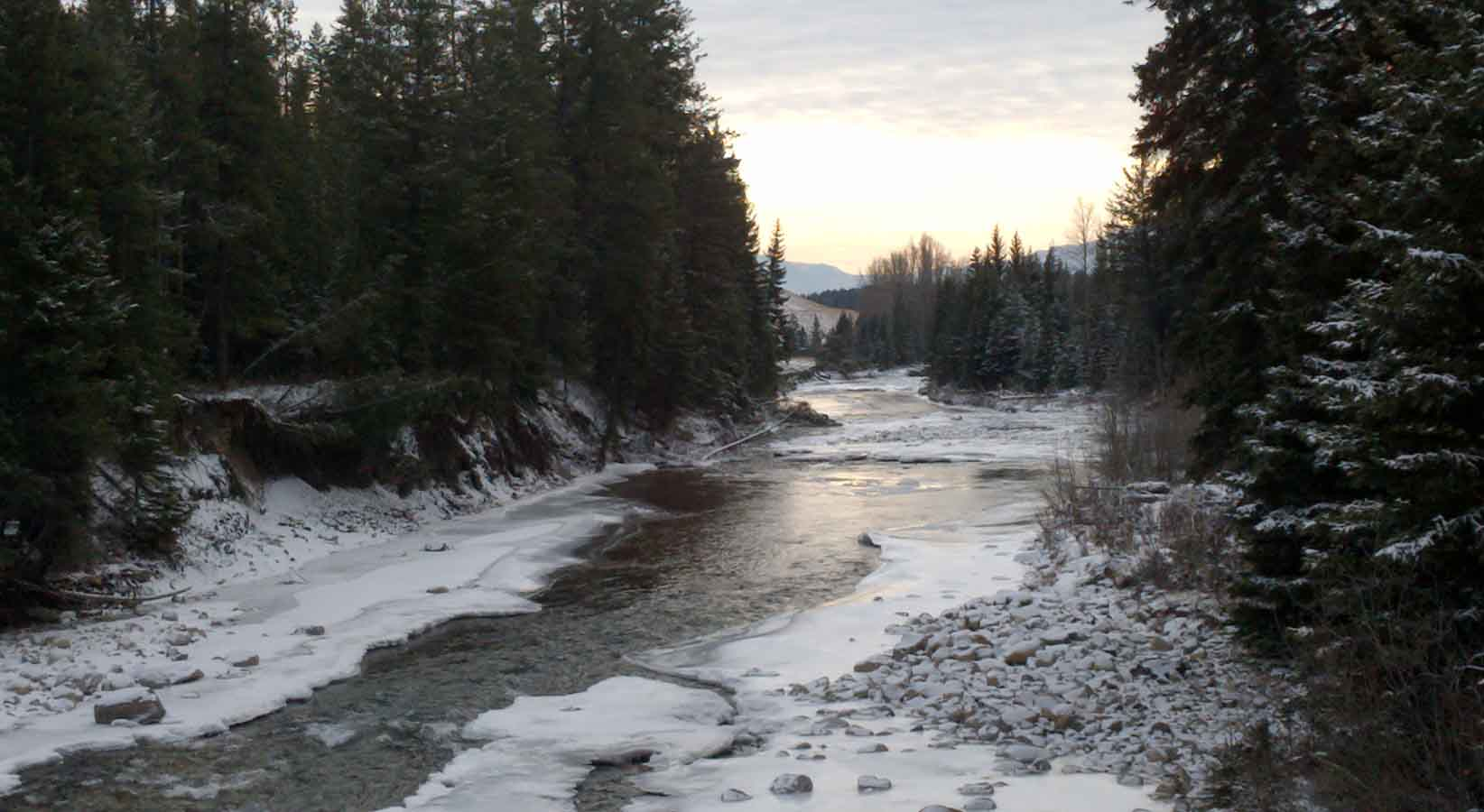 East Kootenay river with snow and ice