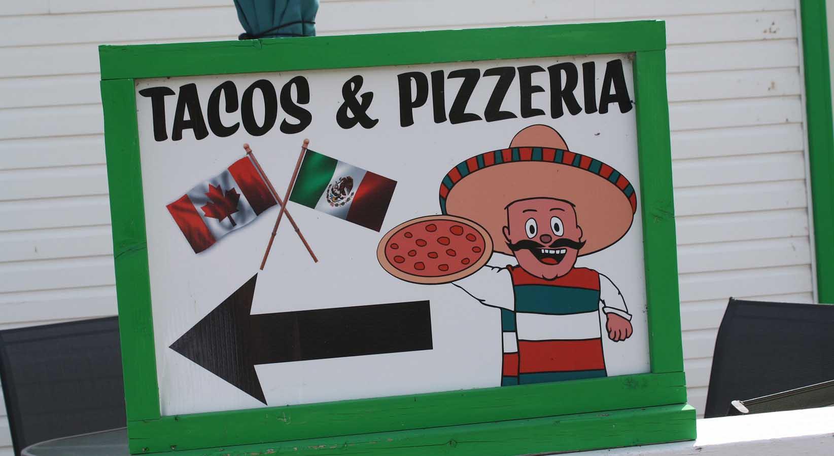 Senor Duggies Tacos & Pizzeria sign