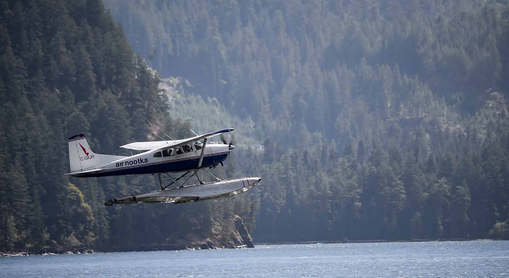 Float plane taking off from the water