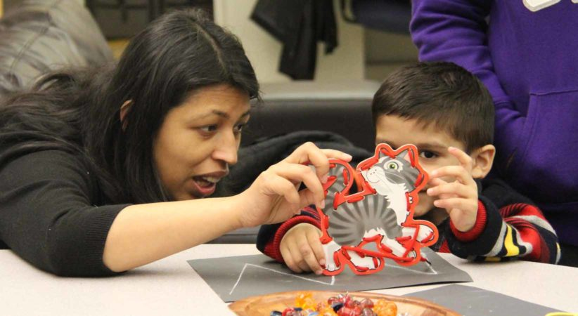 Aliza interacts with a child at an IPALS event.