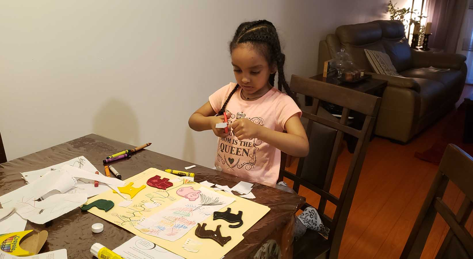 Simret's daughter Azahel playing at a table.