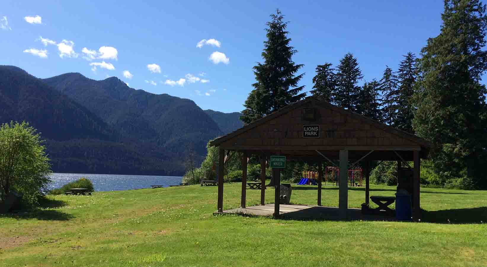 Lions Park in Port Alice. View of a shelter with water and mountains in the background.