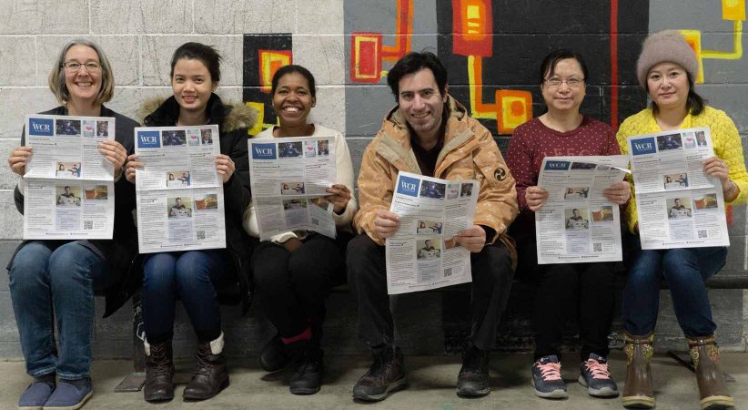 Group of six people holding the Westcoast Reader